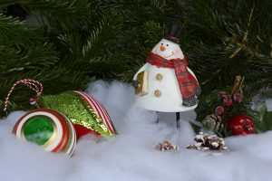 Small snowman decoration surrounded by snow
